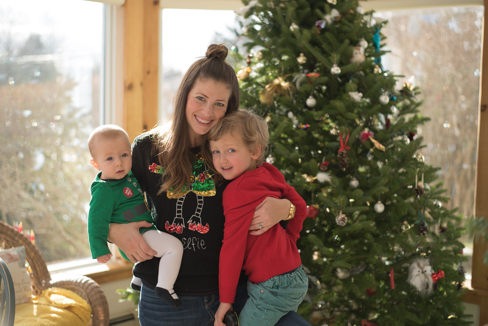 Wild Rosebuds first christmas as a family of four with matching Pjs, ugly sweaters and outside fun