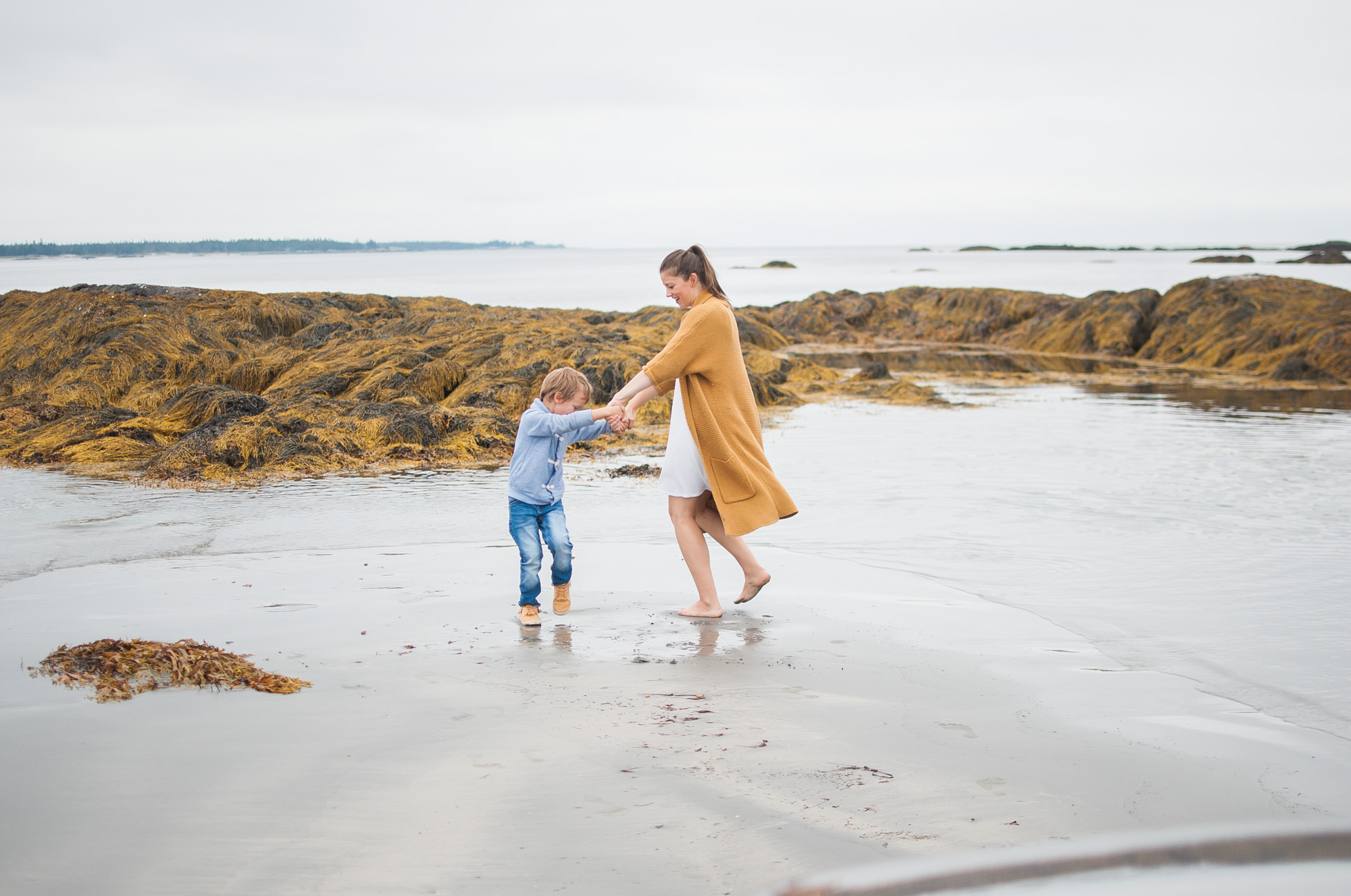 Wild Rosebuds: Mother and Son Dancing on Crescent Beach