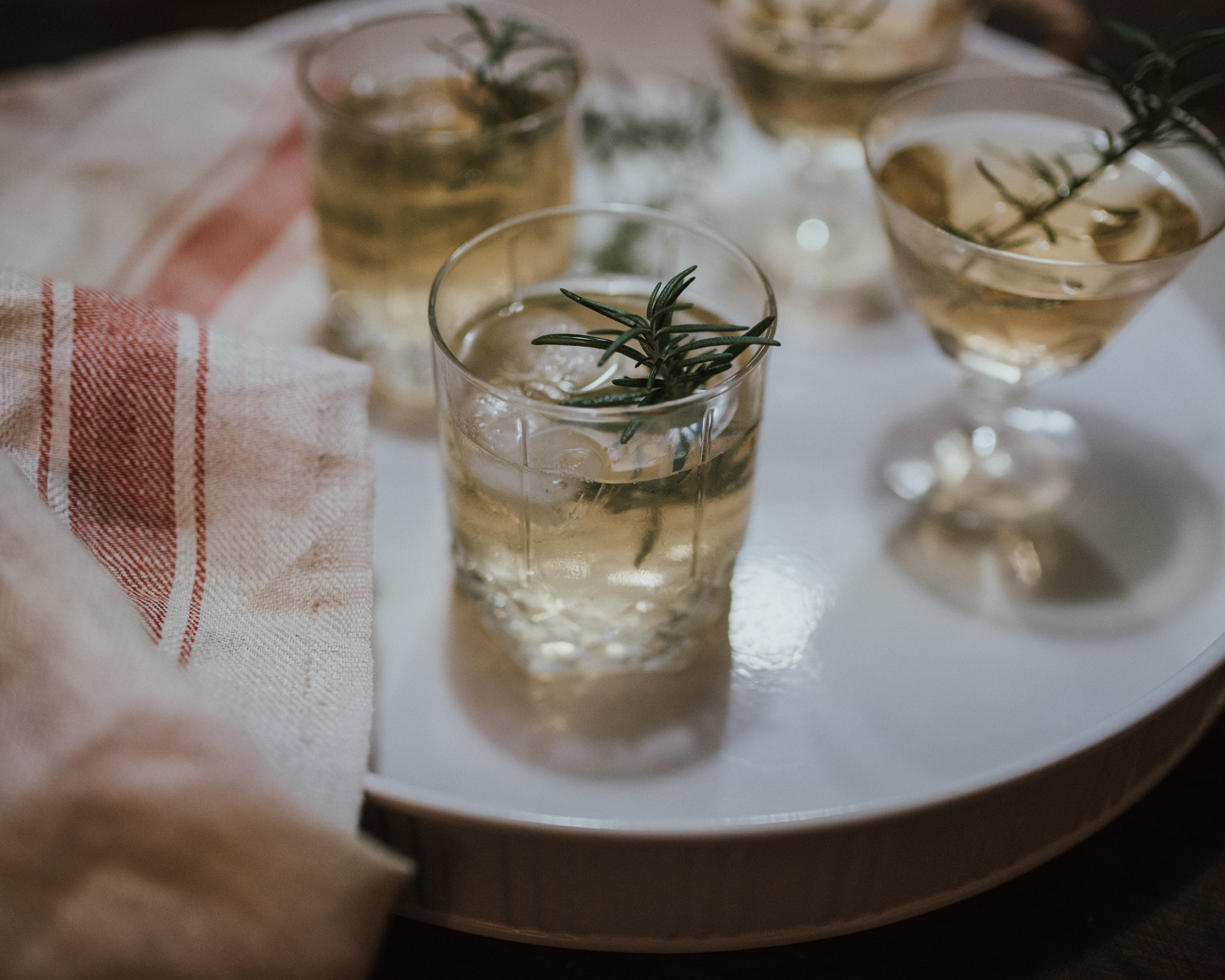 Wild Rosebuds | Cocktails with Dillon's Distillery | Wild Decoeli cocktail made with homemade rosemary simple syrup, Rye, ginger bitters, and topped with Champagne
