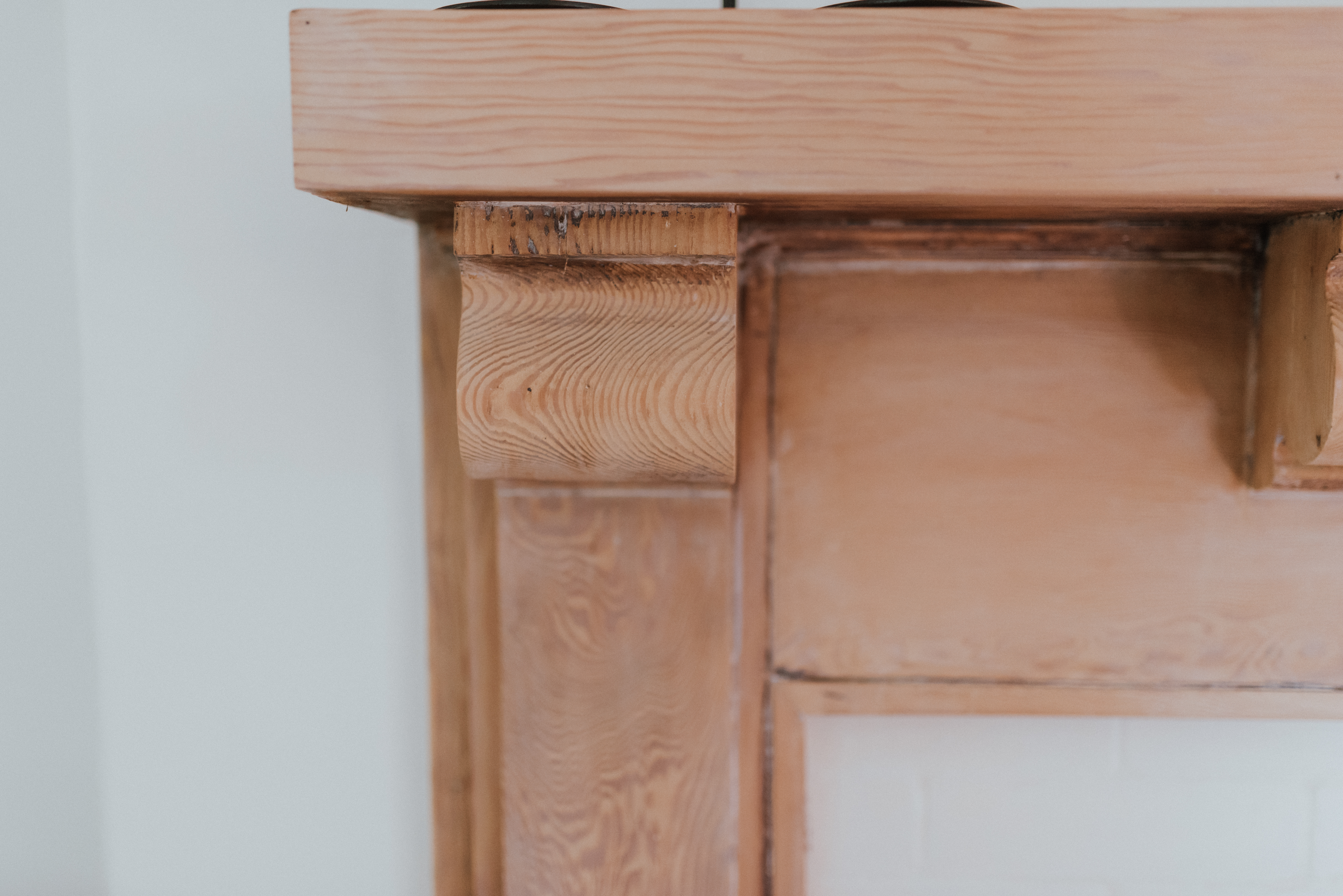 The Wild Decoelis | Taking a Fireplace Mantle From dark Antique Stain to Whitewashed | beautiful grain on antique mantle