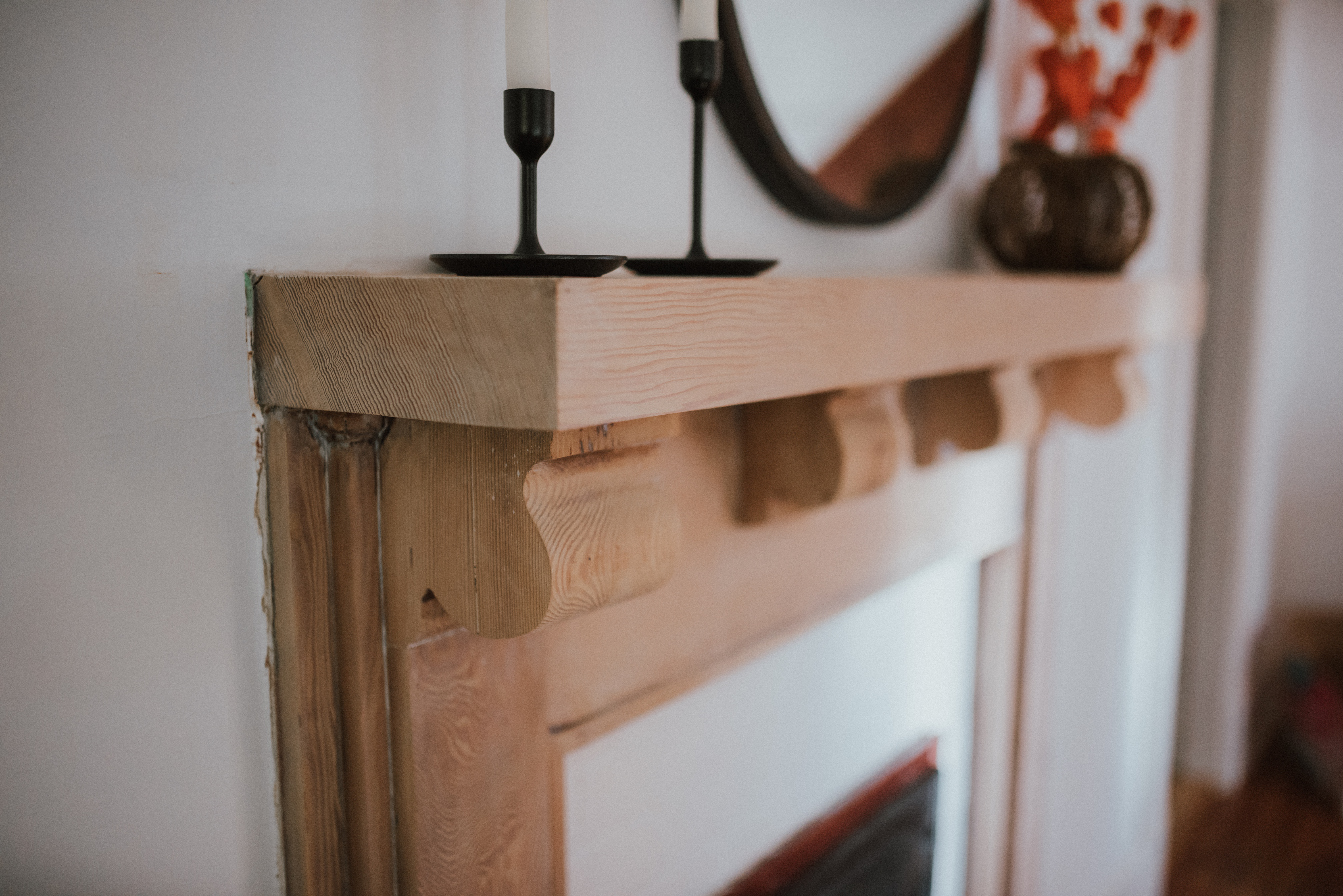 The Wild Decoelis | Taking a Fireplace Mantle From dark Antique Stain to Whitewashed | craftsman home vintage mantle