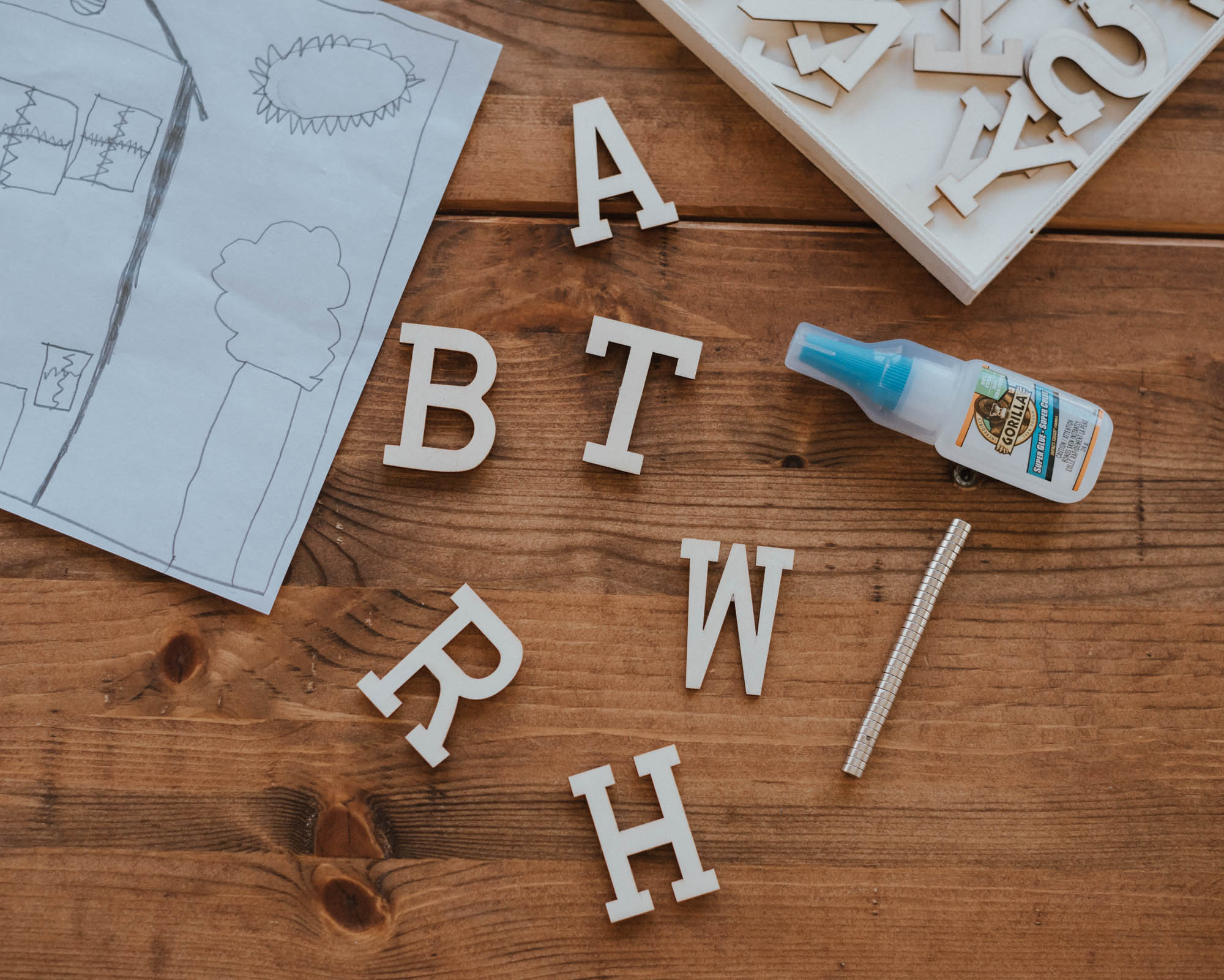DIY Wooden Letter Magnets | The Wild Decoelis