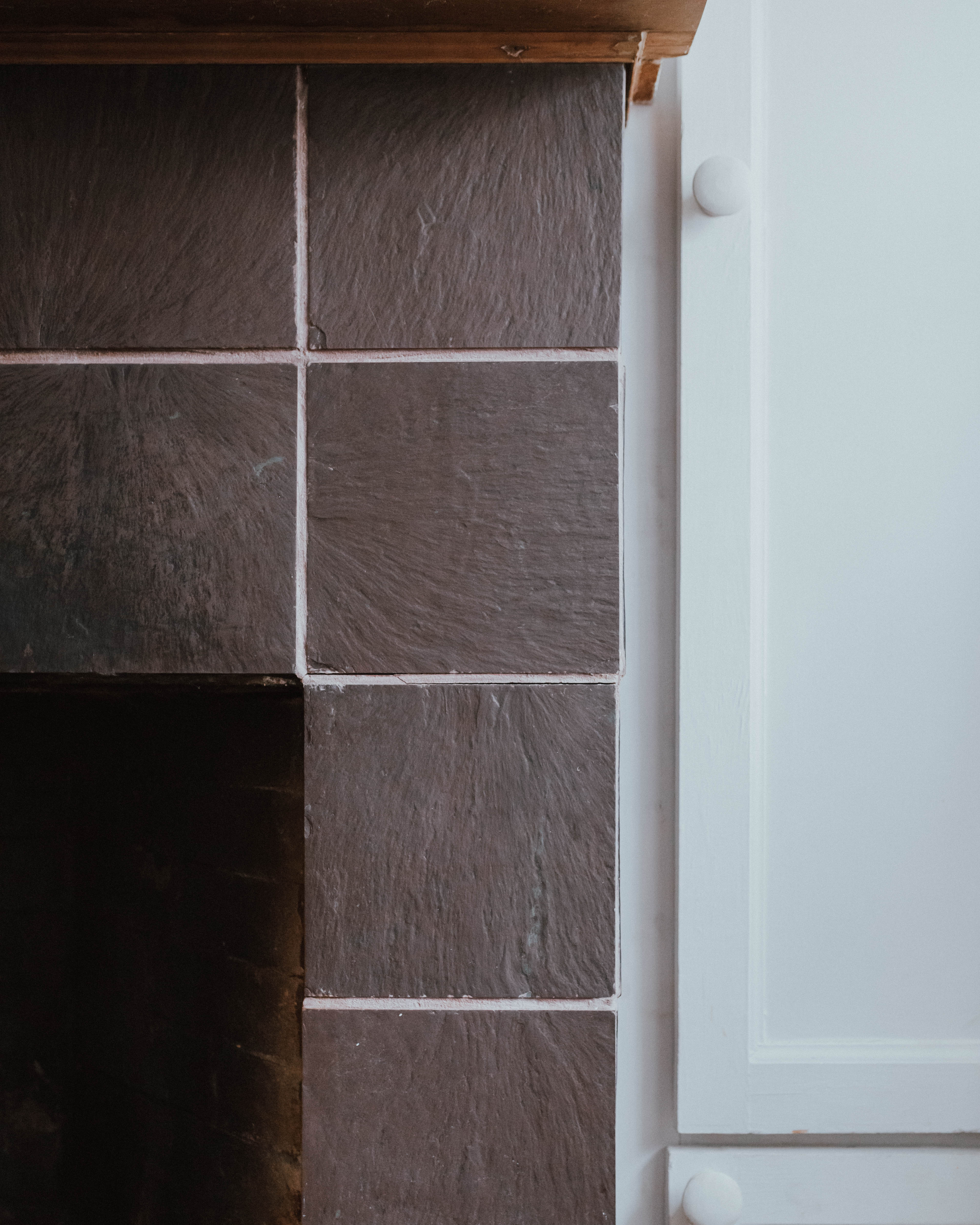 My $100 Fireplace Makeover with Behr Paint | The Wild Decoelis | tired, dirty tile