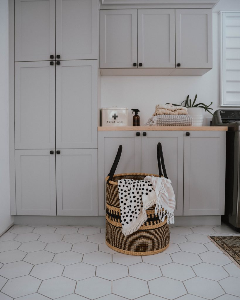 The Wild Decoelis | African woven laundry basket in grey laundry room