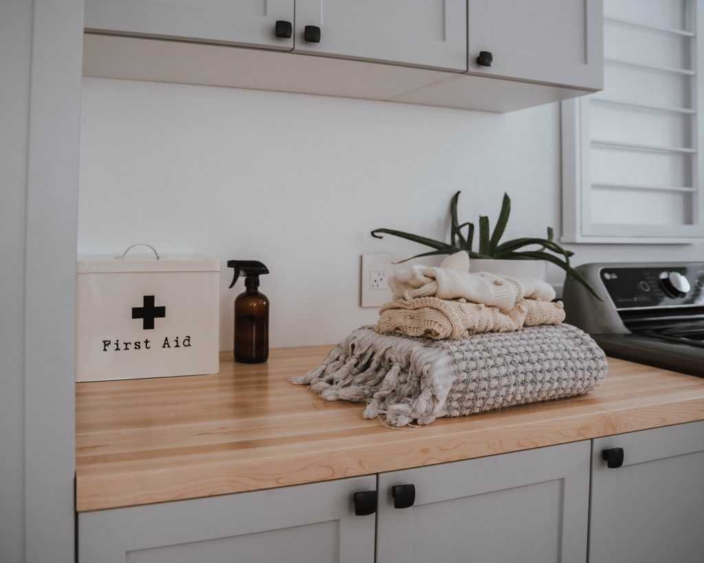 The Wild Decoelis | butcherblock counter in laundry room for folding