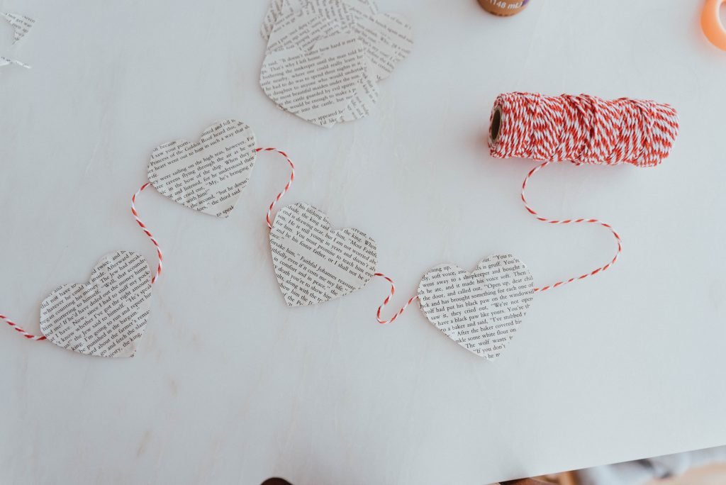 The Wild Decoelis |Valentines day DIY garland made with old thrifted book pages and string, super simple