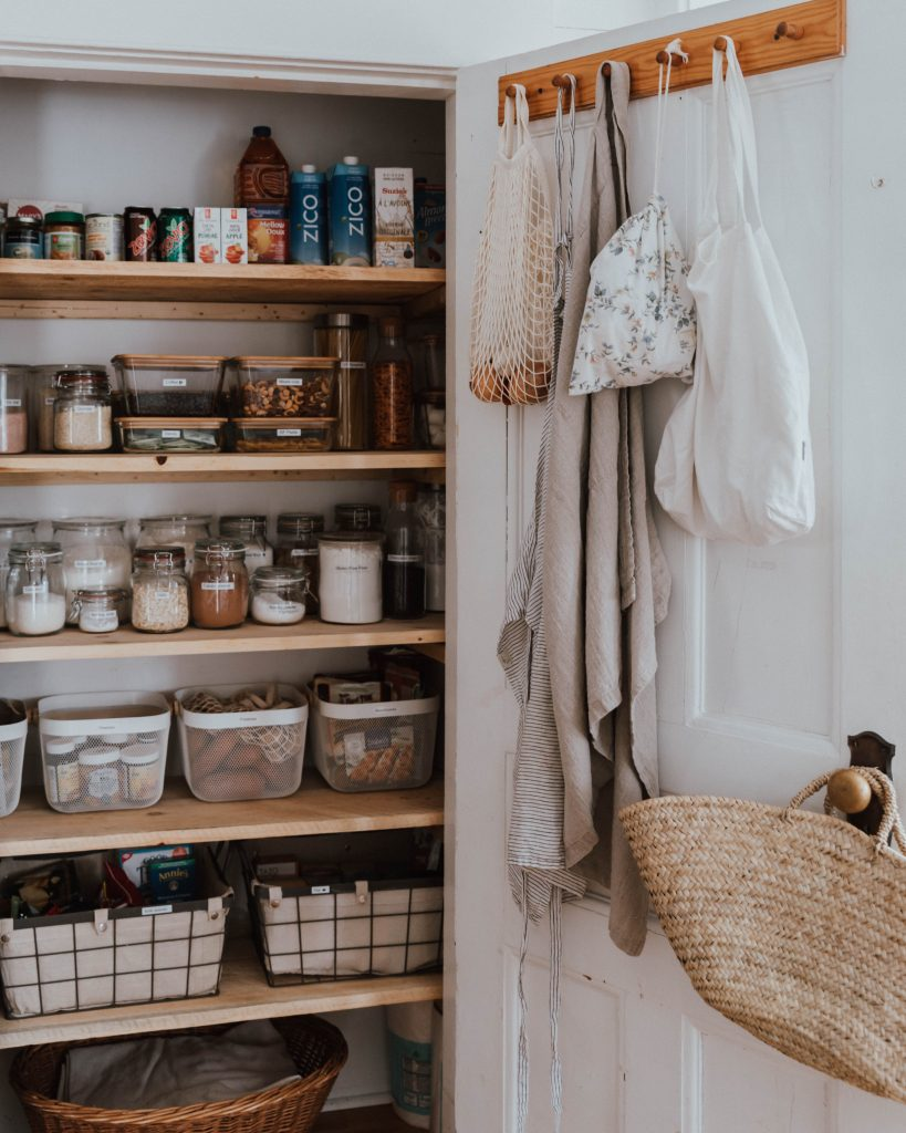 The Wild Decoelis | 7 Easy Tips for Organizing Your Pantry | farm house vibe of organizing a pantry with wood and glass