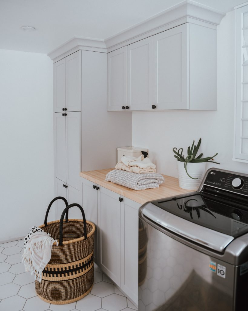 The Wild Decoelis | 5 Reasons Why We Went With A Top Loading Washer |  grey and white laundry room with butcher block countertops