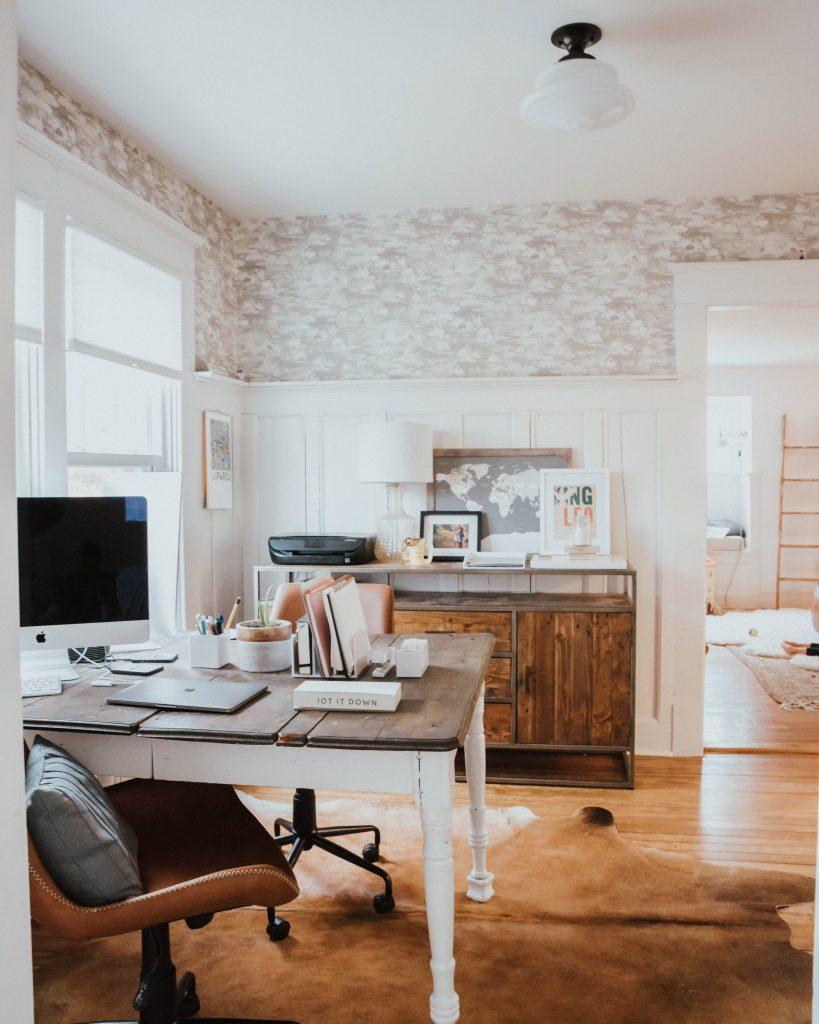 The Wild Decoelis | Top Tips For Working From Home When Kids Are Home  | home office with antique Dining table as desk and wallpaper, schoolhouse light, and credenzaas desk and wallpaper, schoolhouse light, and credenza