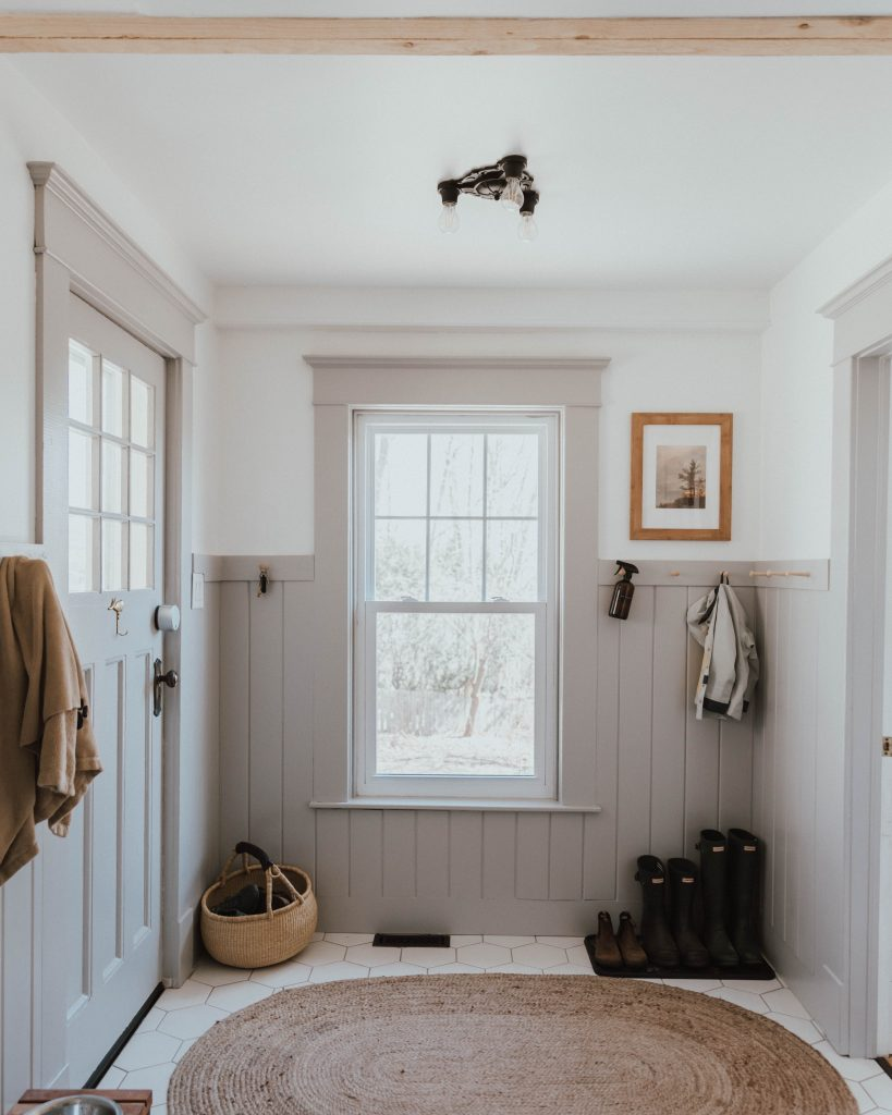 The Wild Decoelis | Our  Traditional Farmhouse Laundry and Mud Room | grey wainscotting and shaker peg rails