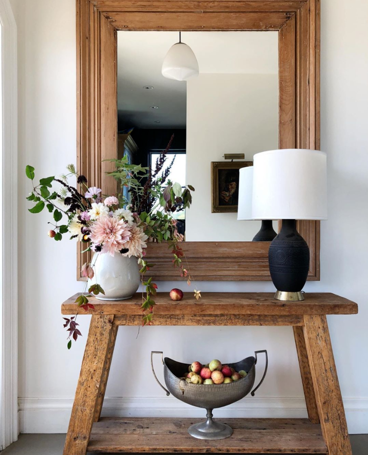 The Wild Decoelis | One Room Challenge: Our Formal Living Room | rustic entryway table, grey vase, black table lamp, large wooden mirror