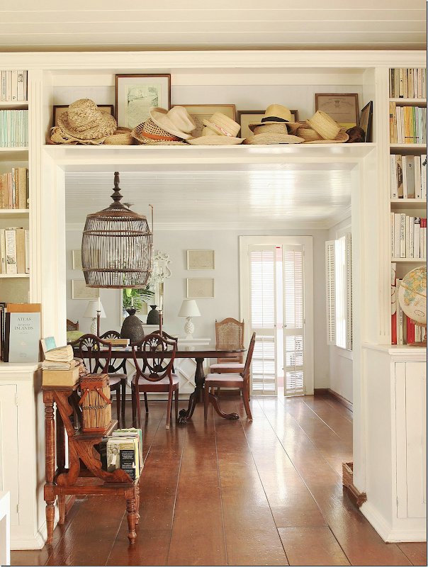 The Wild Decoelis | One Room Challenge: Our Formal Living Room | built ins around a doorway with vintage books.