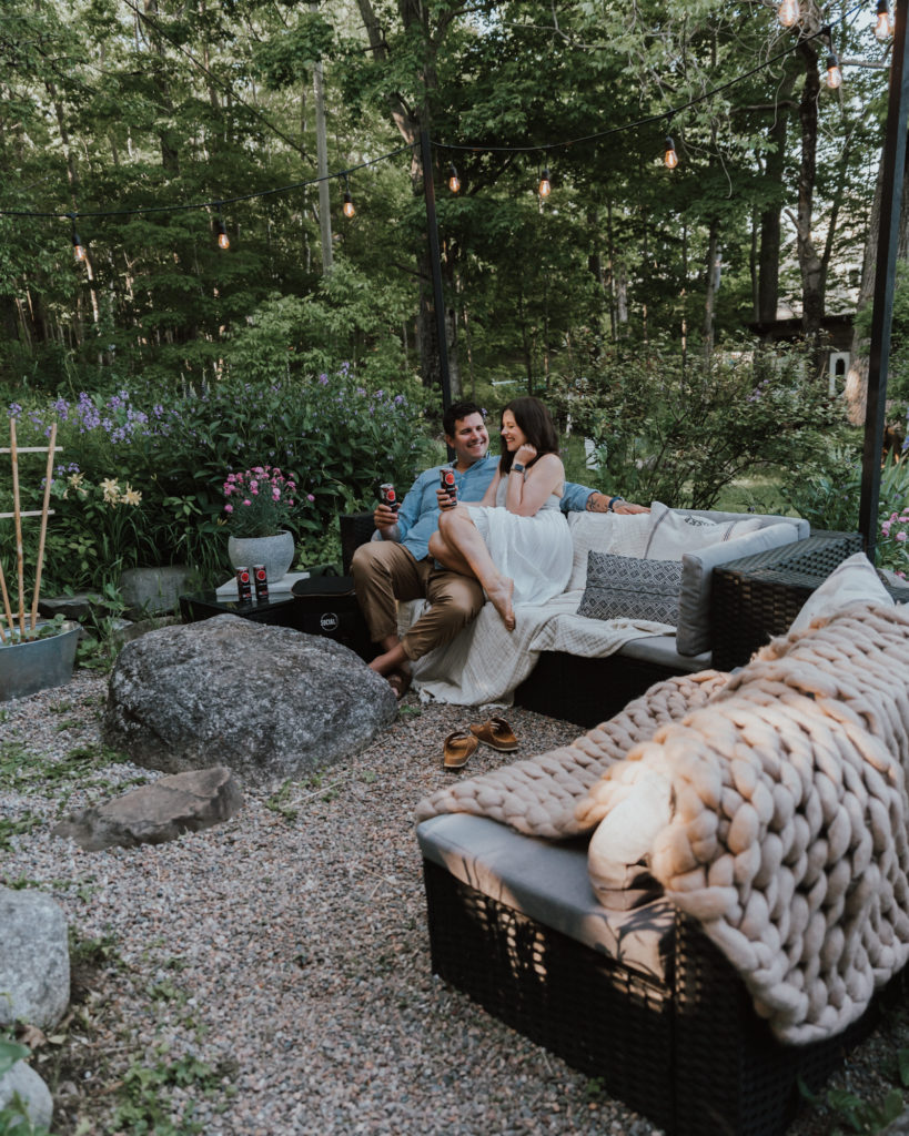 The Wild Decoelis | 5 Tips for a Great Date Night At Home - With SoCIAL Lite Vodka | pea gravel patio and fire pit