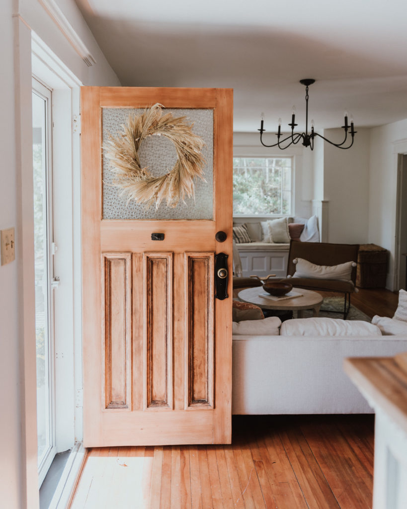 The Wild Decoelis | Fall Home Tour | stripped raw wood front door with fall wreath