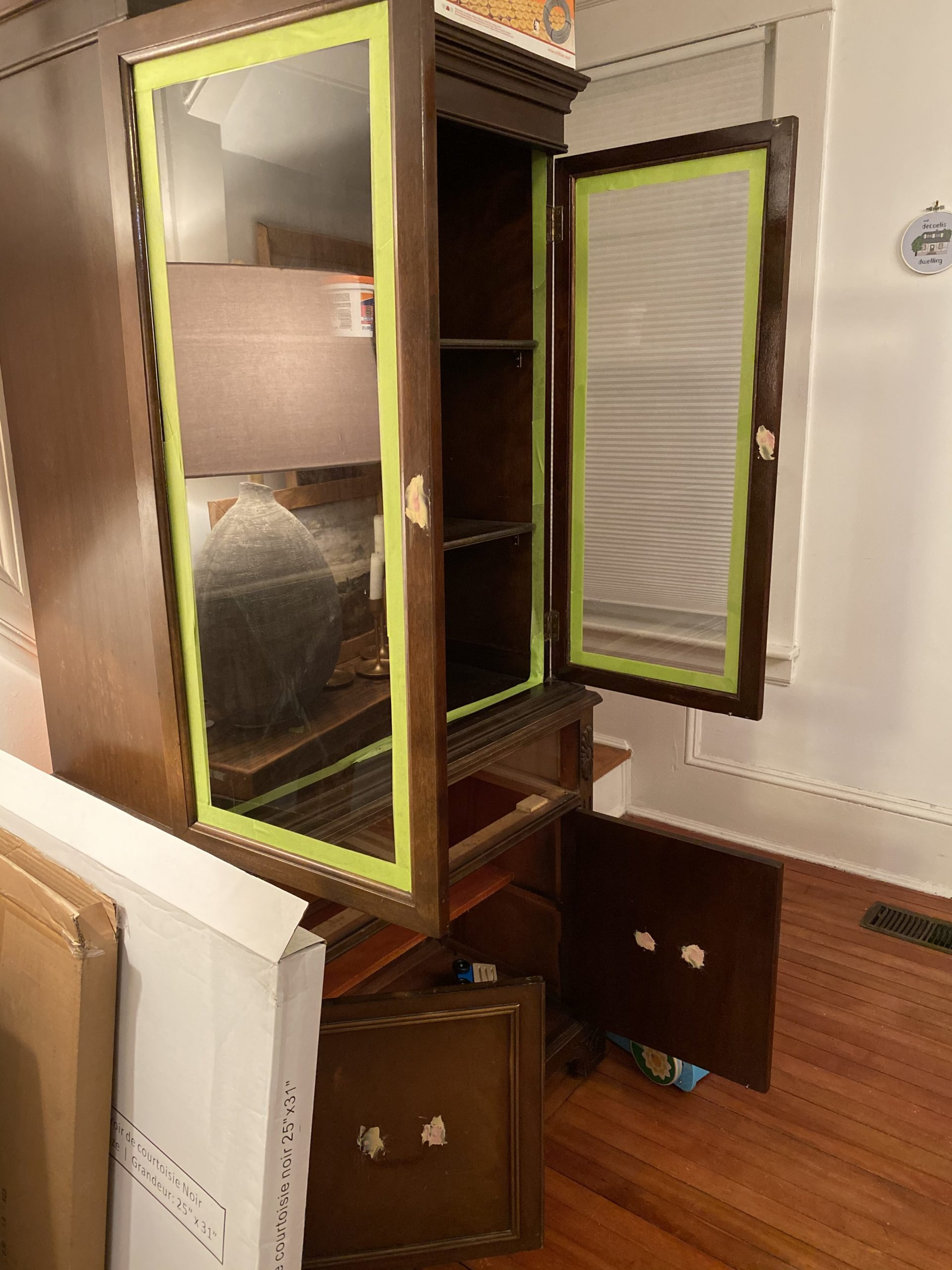 How to Refinish a China Cabinet For a Bathroom   the wild decoelis   matte black antique medicine cabinet with white grey interior in bathroom for storage with baskets and towels black clawfoot tub, vintage rug