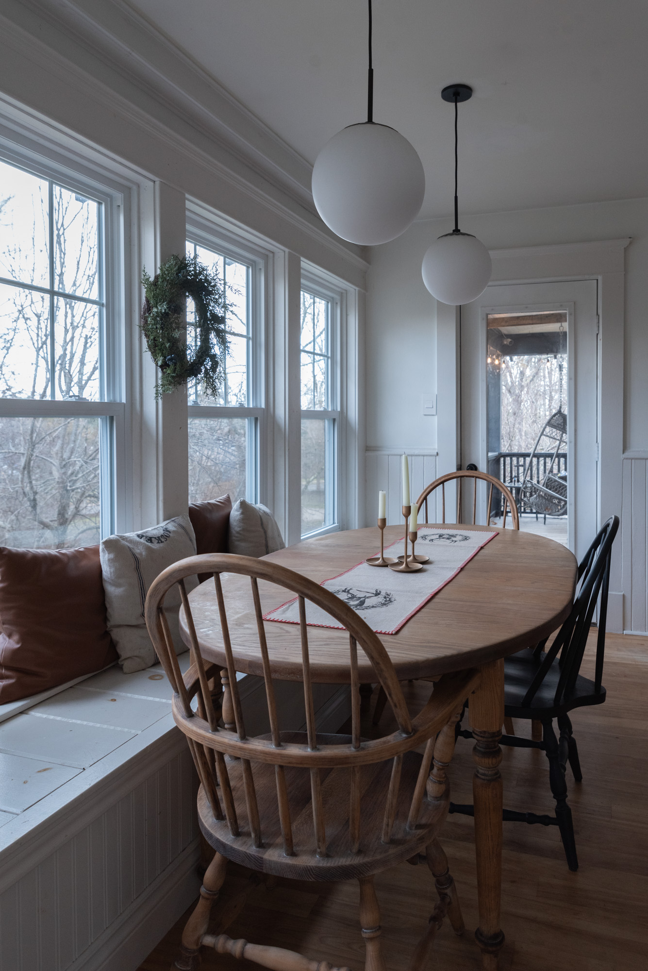 The Wild decoelis | 2020 Holiday Home Tour | Antique kitchen table with reindeer runner wreath and antique golden candlesticks