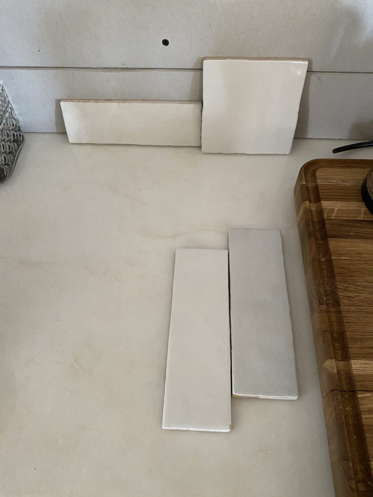 The Wild Decoelis |  Our Kitchen Tile |  White Mallorca tile by Centura in a 4x4 square with white grout in kitchen with floating shelves zellige tile, Fes tile